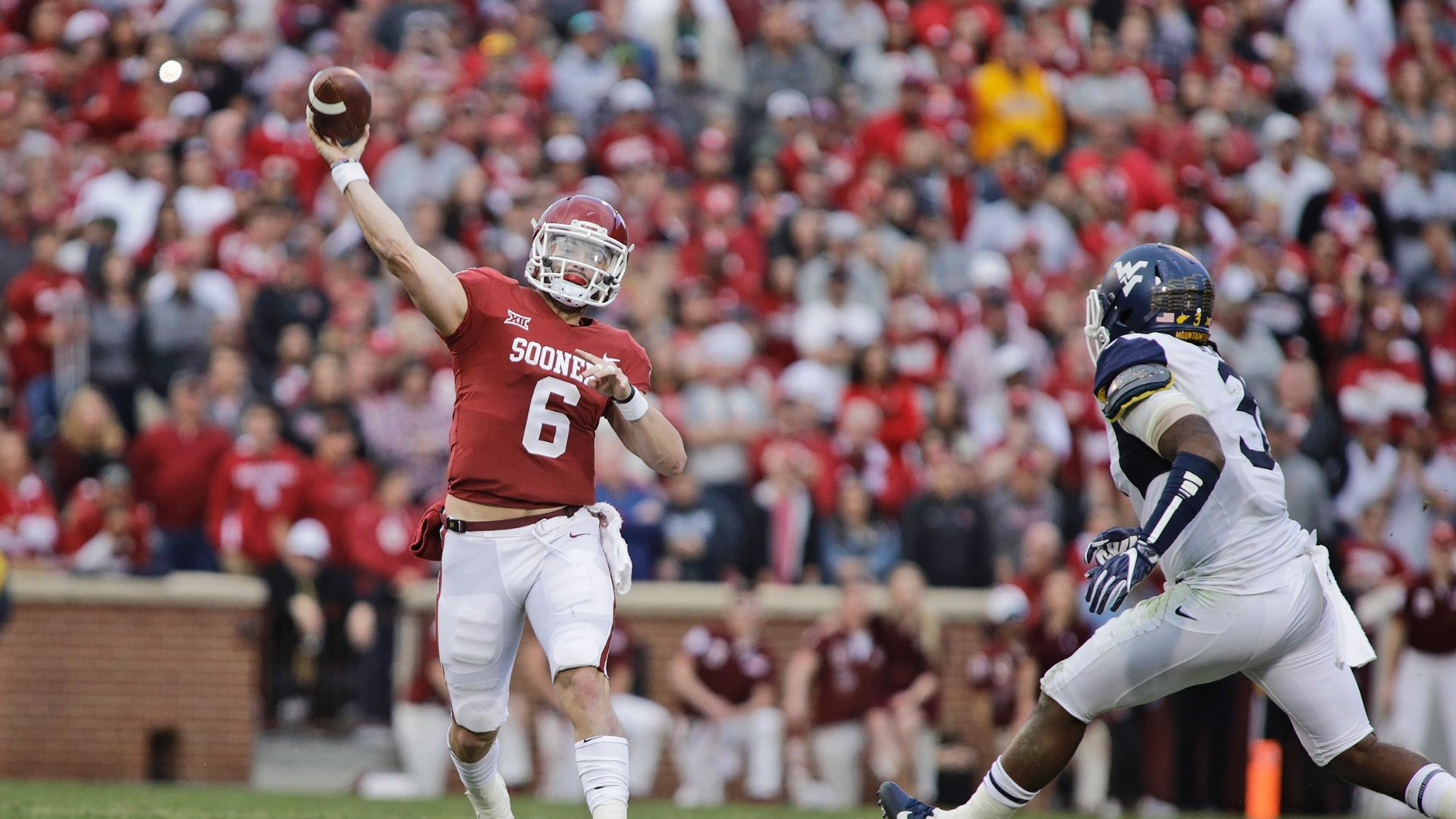 After two-play suspension, Baker Mayfield comes off bench to crush West Virginia