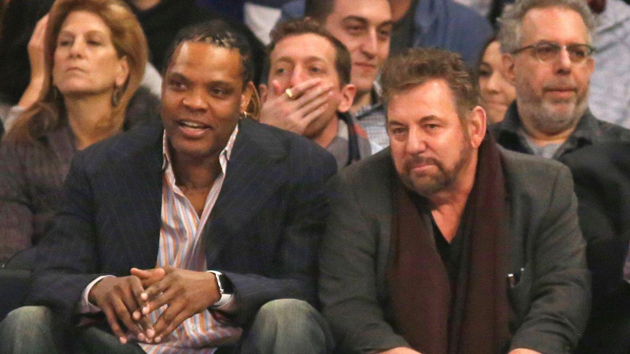 Latrell Sprewell sits near New York Knicks owner James Dolan at