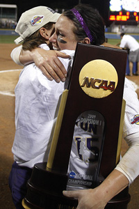 Washington ace Danielle Lawrie, right, helped the Huskies clinch their first softball title with a two-game sweep.