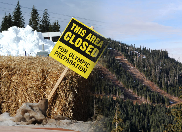 A stockpile of snow brought in by helicopter waits to be spread at Cypress Mountain Feb. 6. Games organizers had to move 300 truck-loads of snow to two courses on Cypress Mountain, as Vancouver saw its warmest January on record.