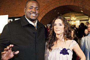 Quinton Aaron and Sandra Bullock made Ravens offensive tackle Michael Oher a household name.