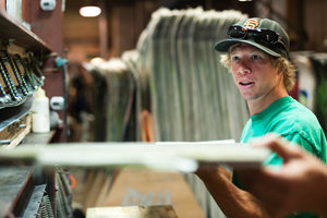 Dutton building limited-edited Rasta POW NAS skis at the Lib Tech factory in northern Washington earlier this fall.