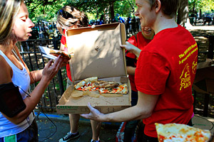 Runners must stop at three checkpoints to inhale a slice of pizza during the 2.25-mile New York City Pizza Run.