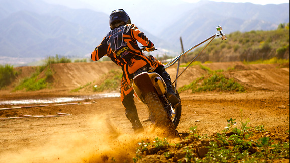 Justin Barcia rails a turn on Honda's private supercross while rocking the crazy custom Go Pro mount.