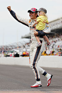 Dan Wheldon with son Sebastian following his win at the 2011 Indianapolis 500.