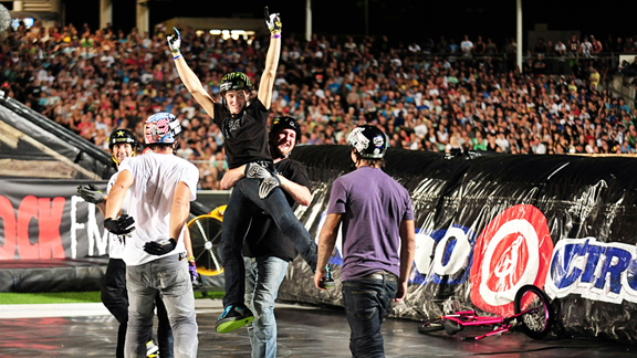 Andy Buckworth, surrounded by fans and friends just after landing the world's first no-handed double frontflip during the New Zealand leg of the Nitro Circus tour in March.