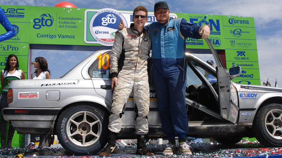 Bill Caswell (left) and co-driver Ben Slocum at the 2010 Rally Mexico finish.