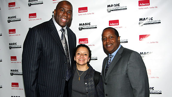 Chrysa Chin, between Earvin 'Magic' Johnson, left, and Eric Holoman, is the first NBA official a new draftee meets.