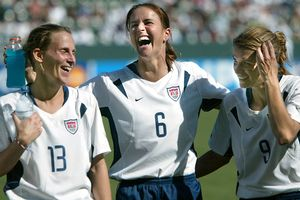 Brandi Chastain (middle), Kristine Lilly and Mia Hamm enjoy a lighter moment after winning the third-place match against Canada at the 2003 World Cup.