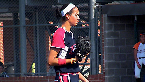 USSSA Pride pitcher Cat Osterman went out in the fifth inning after clutching her throwing arm in obvious pain.