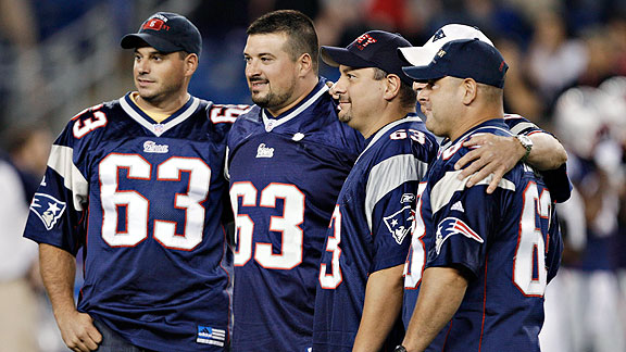 Joe Andruzzi, second from left, with his three New York City firefighter brothers and his father, a former New York City police officer, were honored before a preseason game on Sept. 1, 2011.