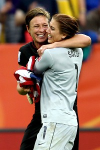 Solo celebrates with teammate Abby Wambach after winning in a shootout during the 2011 Women's World Cup quarterfinal against Brazil.