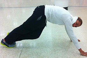 With six hours to kill in the Miami airport on her way back from Colombia, de Souza gets some stretching in.