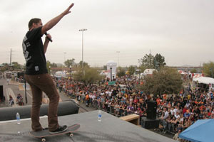 Brian Sumner gives a sermon after a skate demo.