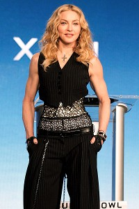 Madonna took questions from the media Thursday, including her polite decline of one reporter's request for a kiss.