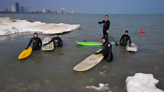 A crew of Great Lakes surfers paddled out in support of Flodstrom after an impromptu press conference and beach clean-up at Montrose Beach.