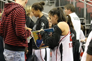 Win or lose, Shoni Schimmel signs autographs after the game, helping to give fans a more personal experience.
