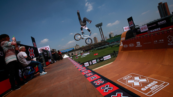 Chad Kagy stretches a superman seatgrab Indian air during X Games Asia BMX vert practice in Shanghai, China. Kagy won the bronze medal in his first X Games appearance since breaking his femur in July of 2011.