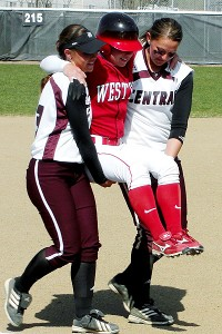 Central Washington's Liz Wallace, left, and Mallory Holtman carried Western Oregon's Sara Tucholsky around the bases in an act of sportsmanship that drew national reaction.