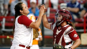 Alabama pitcher Jackie Traina and catcher Kendall Dawson celebrate the Crimson Tide's win over Tennessee in their WCWS opener. Next up, though, is defending champion Arizona State.