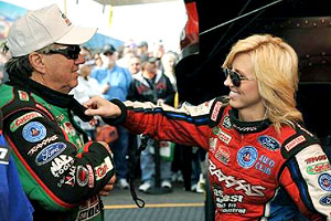 Courtney and her father, 15-time Funny Car champ John Force, spend weekends traveling the NHRA circuit.