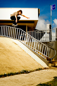Up and over, Collin gets snappy over a rail in Puerto Rico.