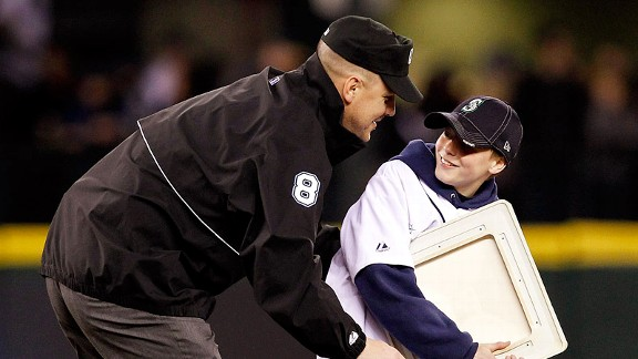 Steve Smerer surprised his son, Kyle, by dressing up as an umpire at a Mariners game.