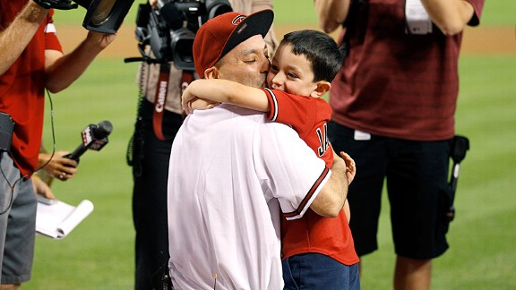 Paul Aguirre's kids thought they were throwing out the first pitch; little did they know, their dad was the catcher.