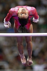 Gabby Douglas dismounts the uneven bars during Friday's preliminary round.
