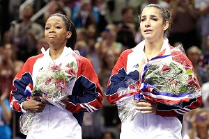 Gabby Douglas, left, and Aly Raisman are overcome with emotion after making the Olympic team.