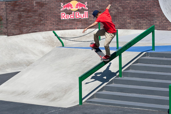 Ryan Sheckler nose blunts the big rail on the street course.