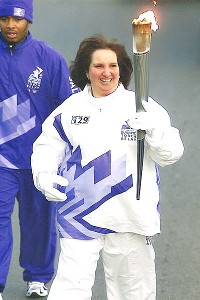 Donna Goldman, who carried the torch at the 2002 Salt Lake Winter Games, was so inspired that she was able to go part of her route without using the cane she usually needs to walk.