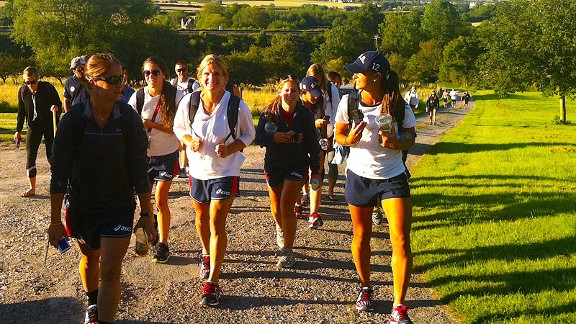 The U.S. field hockey team enjoys a walk in the countryside near their cottage in Cotswold, England.