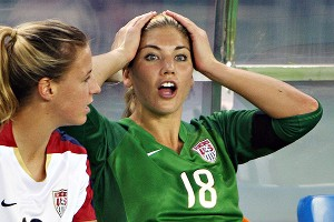Replaced U.S. goalkeeper Hope Solo, right, sat on the bench with teammate Aly Wagner during the 4-0 loss to Brazil.