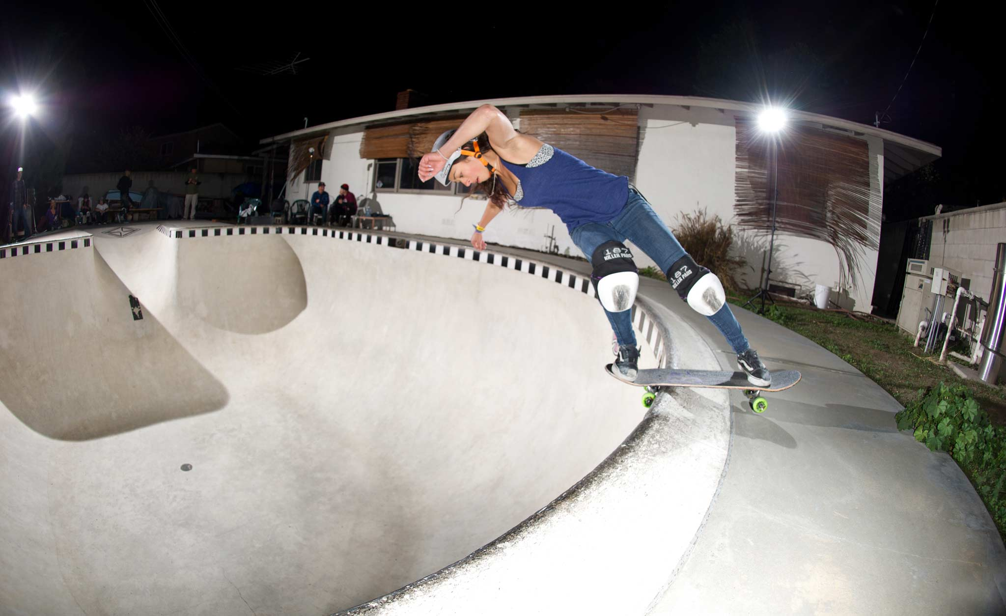 Lizzie Armanto boardslides at Kelly Belmar's backyard pool.