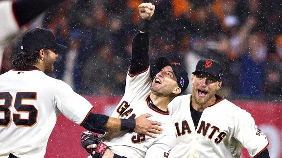 The Giants' Marco Scutaro, center, celebrates with teammates at the end of Game 7. San Francisco moves on to face the Tigers in the World Series.