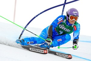 Tina Maze skied a perfect first run and then held on for a season-opening World Cup giant slalom win.