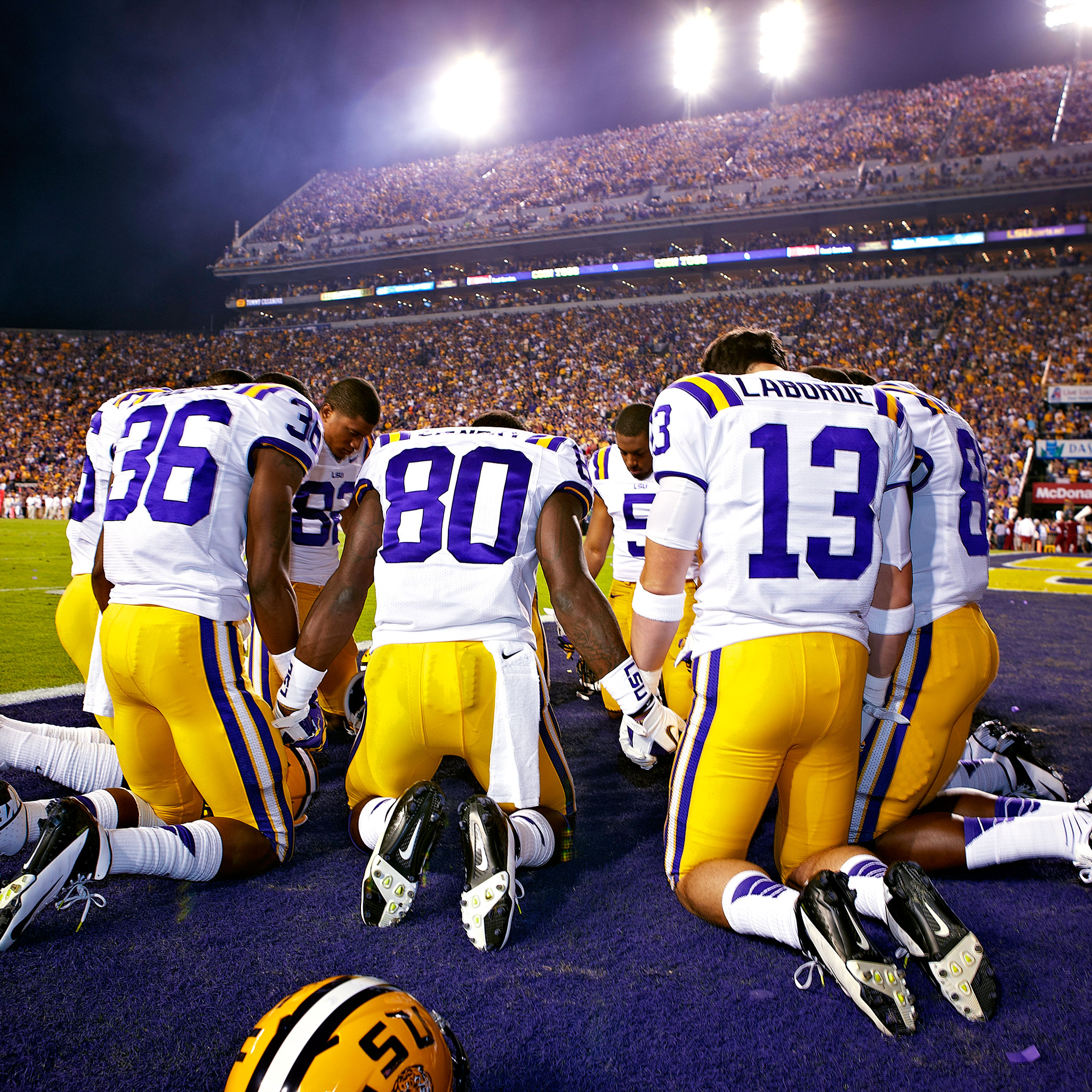 LSU players pray before the game