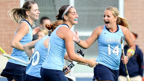 North Carolina's Kelsey Kolojejchick, right, celebrates her team's third goal against Syracuse during the semifinals.