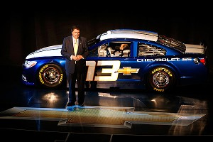 NASCAR president Mike Helton speaks on stage during the NASCAR unveiling of the 2013 Chevrolet SS.