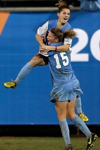 UNC's Kealia Ohai gets a lift from teammate Katie Bowen after finding the far post in overtime to beat Stanford 1-0.