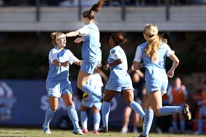 North Carolina's Kealia Ohai (7) celebrates her goal with teammates Amber Brooks (22), Crystal Dunn (19) and Summer Green during Sunday's College Cup championship game.
