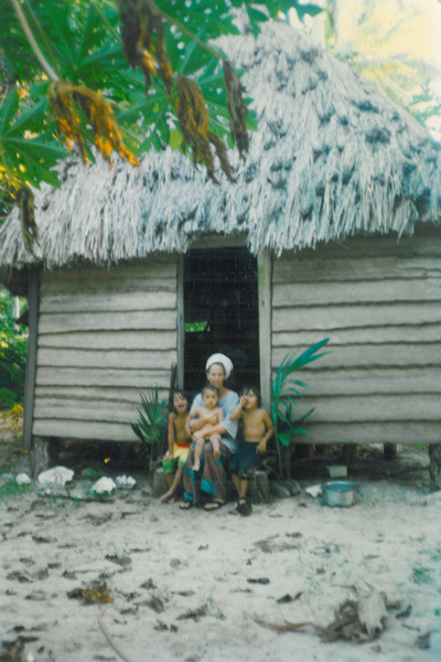 Nyjah on his mother Kelle's lap, with his brothers Jahmai and Ahbi, in front of their Fiji home in 1996.
