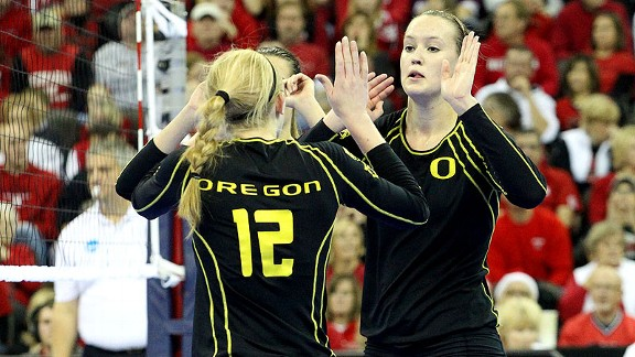 Oregon's Alaina Bergsma celebrates with teammate Katherine Fischer (12) during a recent match.