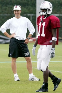 South Carolina receivers coach Steve Spurrier Jr., left, smiles as he watches McKinley, a freshman, during practice in August 2005.
