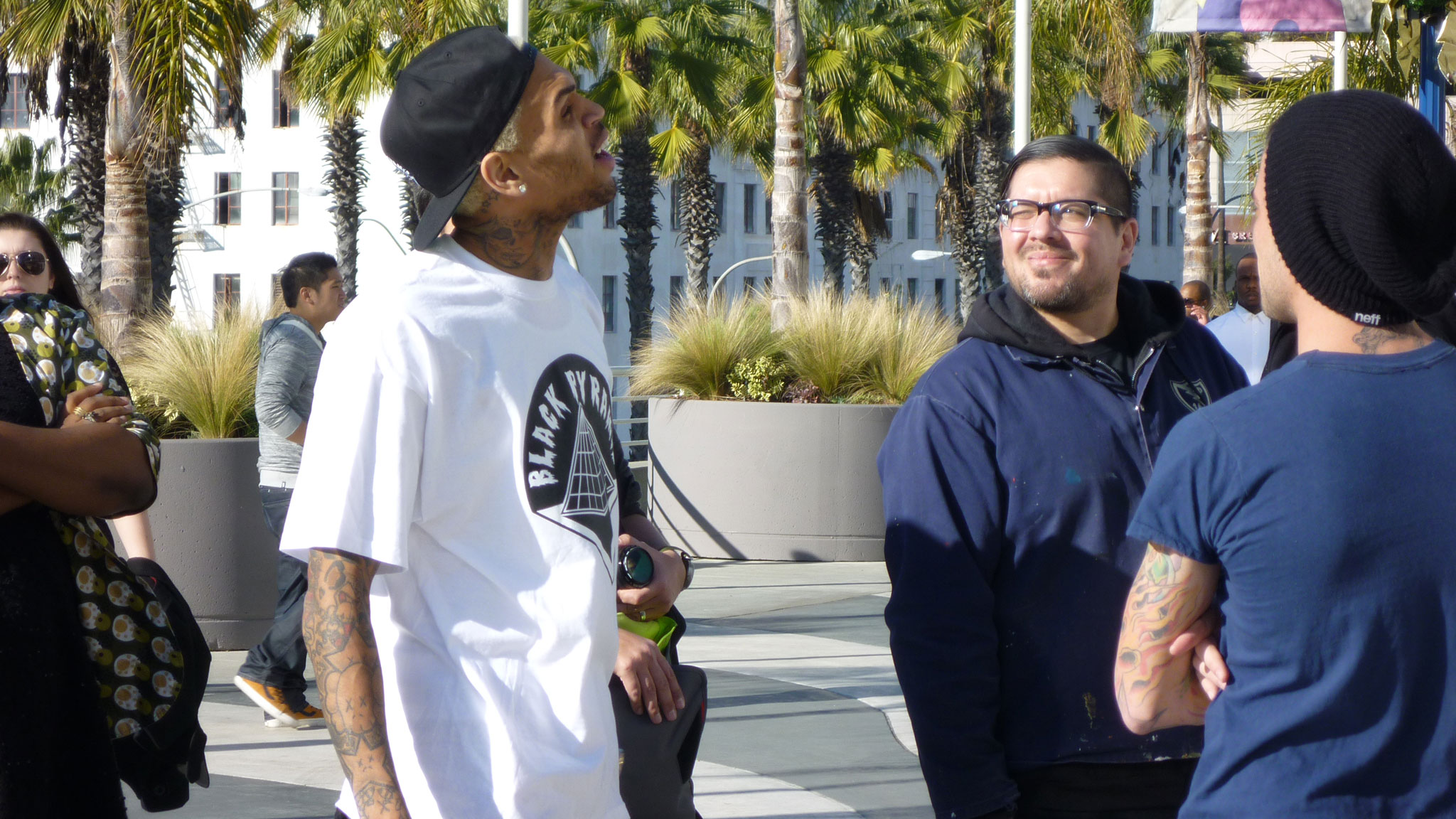 Rappers love skateboarding: Chris Brown arrives at Agenda.