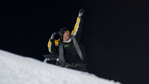 Heath Frisby salutes the crowd after winning Snowmobile Best Trick at X Games Aspen 2012.