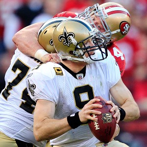 Justin Smith wrangles his way toward Saints quarterback Drew Brees.