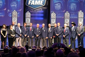 Living members of the NASCAR Hall of Fame gather as the Class of 2013 -- Buck Baker, Cotton Owens, Herb Thomas, Rusty Wallace and Leonard Wood -- was inducted Friday.