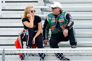 Brittany Force, left, and her father John Force talk during testing at the PRO Winter Warmup.